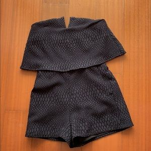 Selling a black romper from design lab